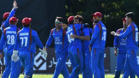 Afghanistan celebrate taking an Ireland wicket in the final ODI at Stormont on Friday