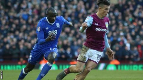 Jack Grealish takes the ball away from Cheikh Ndoye during Aston Villa's win over Birmingham