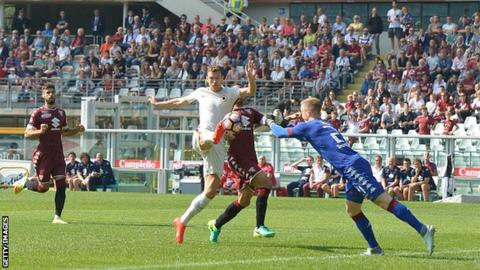 Joen Hart (right) in action for Torino against Roma