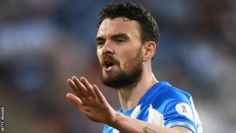 Scott Malone in action for Huddersfield