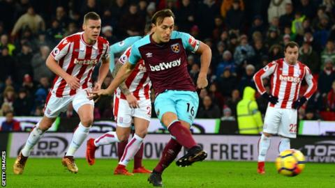 On his 300th League appearance West Ham captain Mark Noble gives his side the lead from the penalty spot