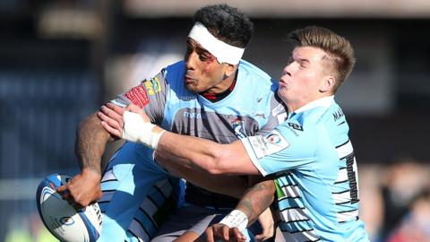 Rey Lee-Lo of Cardiff Blues is tackled by DTH van der Merwe and Huw Jones of Glasgow