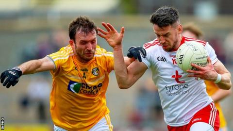Antrim's Patrick Gallagher with Mattie Donnelly of Tyrone