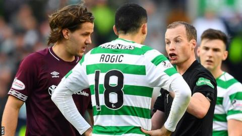 Hearts' Peter Haring and Celtic's Tom Rogic are given a talking to by referee Willie Collum