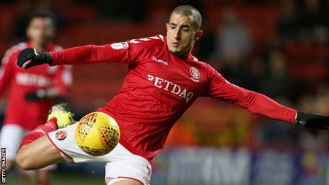 Charlton midfielder Ahmed Kashi prepares to volley a ball
