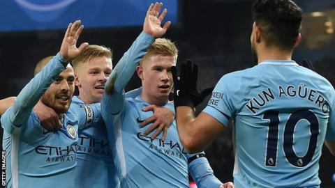 Manchester City's players celebrate a goal against Newcastle in the Premier League