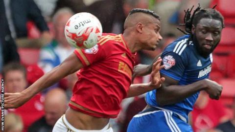 Cardiff City striker Kenwyne Jones rises to put his side ahead