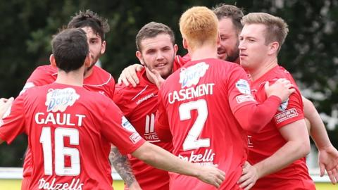 Darren Murray is congratulated by team-mates after scoring the opening goal in Portadown's 2-1 win away to Ballinamallard United