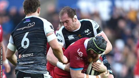 Jake Ball is tackled by Alun Wyn Jones in a Scarlets v Ospreys match