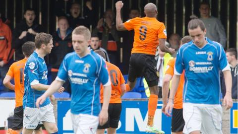 Miguel Chines leaps for joy as he celebrates scoring the first goal of his double for newly promoted Carrick Rangers against Dungannon Swifts