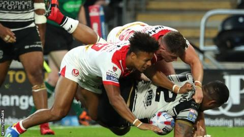 Regan Grace and Morgan Knowles of St Helens tackle Bureta Faraimo of Hull FC during the Super League match between Hull FC and St Helens Saints at the KCOM Stadium