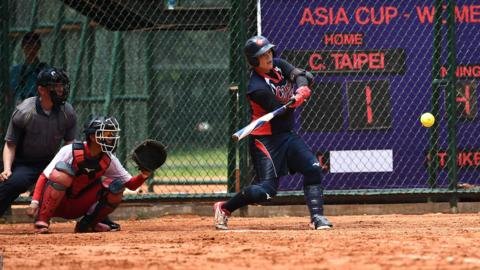JAKARTA, INDONESIA - MAY 05: Li Szu Shih of Chinese Taipei #4 bats during the match between China and Chinese Taipei on day five of the 12th Softball Women's Asia Cup on May 05, 2019 in Jakarta, Indonesia. (Photo by Robertus Pudyanto/Getty Images)