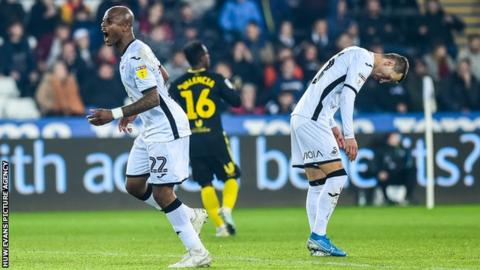 Swansea striker Andre Ayew shows his frustration during their heavy home loss to Brentford