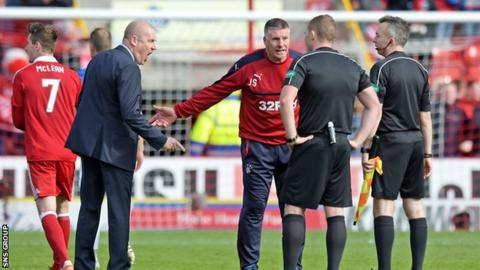 Rangers manager Mark Warburton exchanged words with the match officials on the pitch at full time