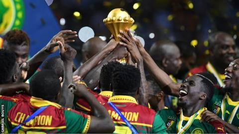 Cameroon players with the Nations Cup trophy after winning the 2017 final