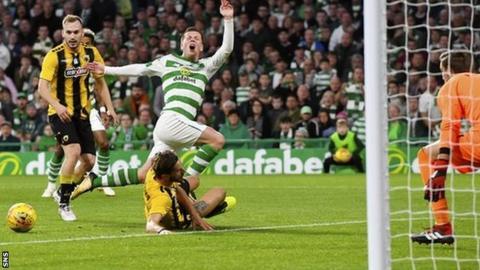 Celtic's Callum McGregor is challenged