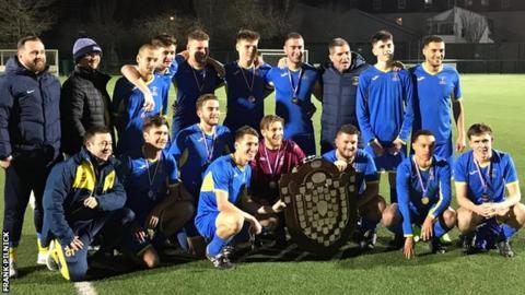 St Clement celebrate Trinity Shield win