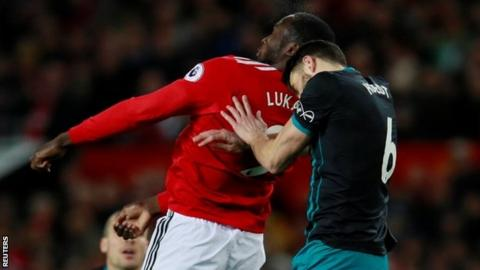 Manchester United forward Romelu Lukaku carried off after clash of heads