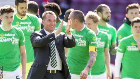 Celtic manager Brendan Rodgers applauds visiting fans at Tynecastle