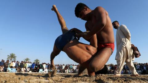 Pakistani men compete in a weekly Graeco-Roman wrestling competition in Dubai on March 16, 2018