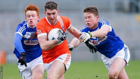 Armagh's Anthony Duffy in action against James Kelly and Kevin Meaney of Laois