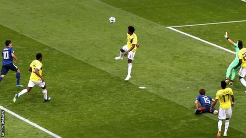 Colombia's Carlos Sanchez handballs against Japan