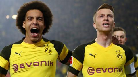 Borussia Dortmund's players celebrate scoring against Bayern Munich