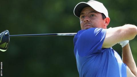 Rory McIlroy watches his drive on the 18th in Sunday's final round