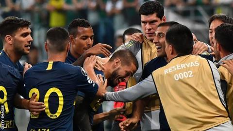 Dario Benedetto (left), of Argentina's Boca Juniors, celebrates his goal