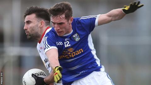 Cavan's Niall Clerkin challenges Tyrone's Tiernan McCann