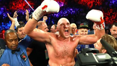 Tyson Fury celebrates victory over Tom Schwarz