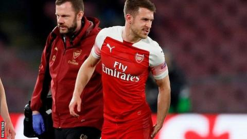 b66b85e0c23 Aaron Ramsey holds his thigh after pulling a muscle on Thursday night