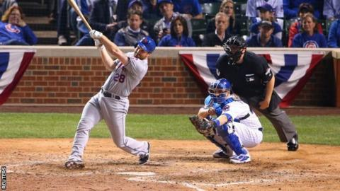 New York Mets second baseman Daniel Murphy hits a two-run home run against the Chicago Cubs