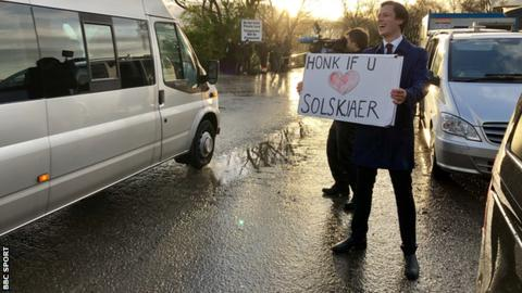"A Norwegian broadcaster held up a placard reading ""Honk if you love Solskjaer"" to all vehicles heading into United's training ground Carrington on Thursday morning"