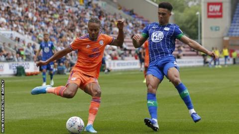 Bobby Reid of Cardiff and Antonee Robinson of Wigan Athletic
