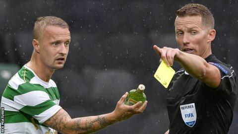 Celtic striker Leigh Griffiths is booked against Linfield