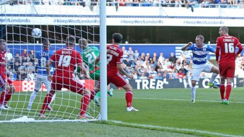 QPR defender Clint Hill heads his side into the lead against Cardiff