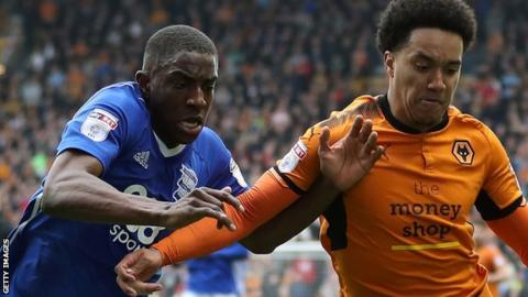 Birmingham's Wes Harding (left) tussles with Wolves winger Helder Costa