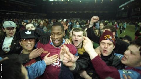 Ehiogu celebrates with Aston Villa fans