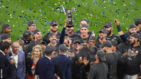 Houston Astros celebrate with the American League Championship Series trophy