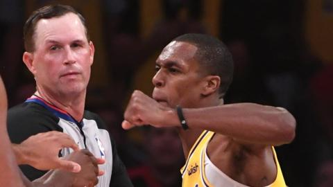 LA Lakers' Rajon Rondo throws a punch in the melee against Houston Rockets