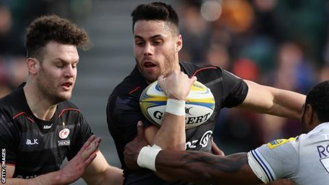 Sean Maitland carries the ball for Saracens against Bath as Duncan Taylor looks on