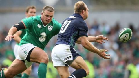 Nathan White is about to tackle Scotland fly-half Greig Tonks in Dublin