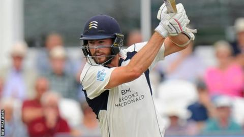 James Fuller plays a shot while batting for Middlesex