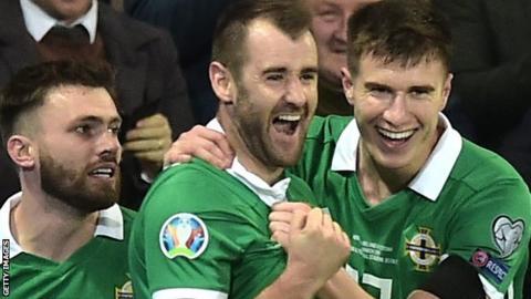 Niall McGinn celebrates scoring for Northern Ireland