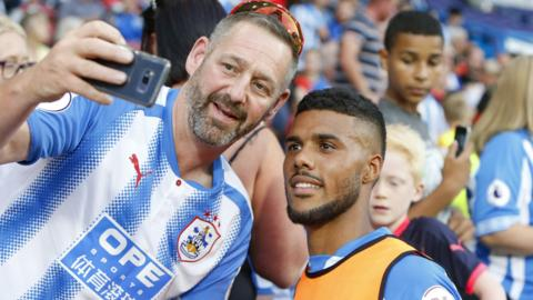 Huddersfield fan with Elias Kachunga