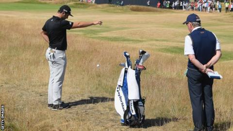 Jon Rahm makes a penalty drop at The Open Championship at Carnoustie