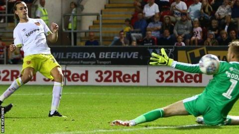 Hull midfielder Jackson Irvine scores against Rotherham