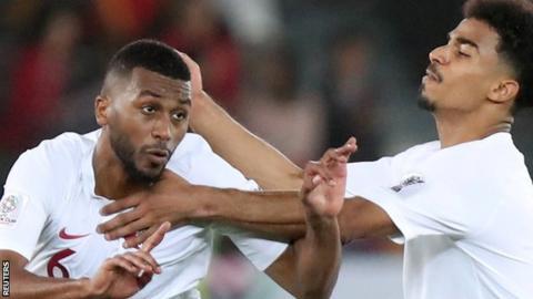 Qatar's Abdelaziz Hatim celebrates