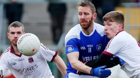 Cavan Gaels captain Michael Lyng is challenged by Slaughtneil's Paul McNeill in the Armagh decider